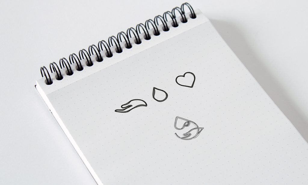 logo sketches on paper