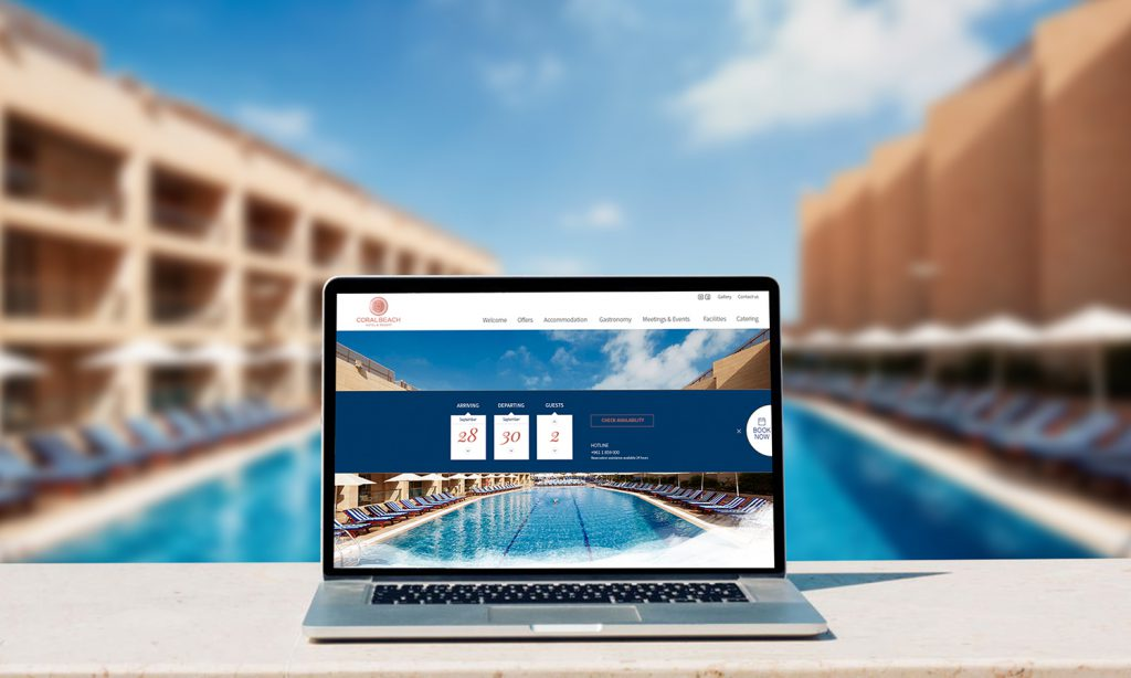 coral beach hotel website on laptop
