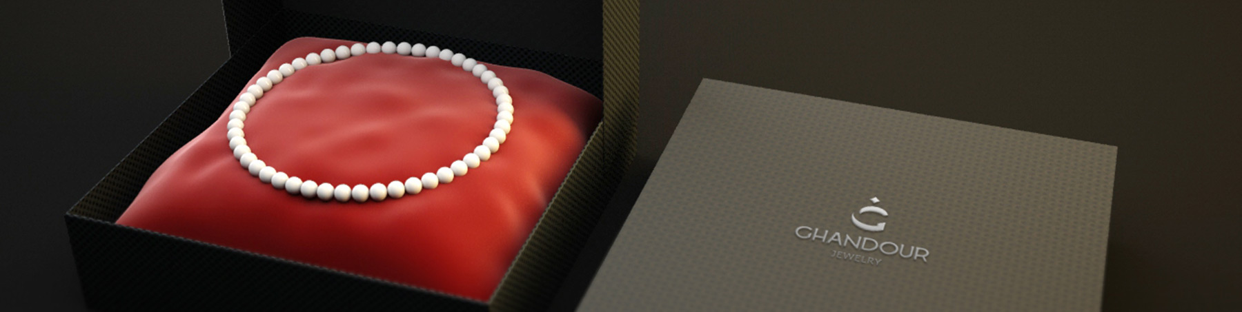 GHANDOUR-logo on box with pearl necklace