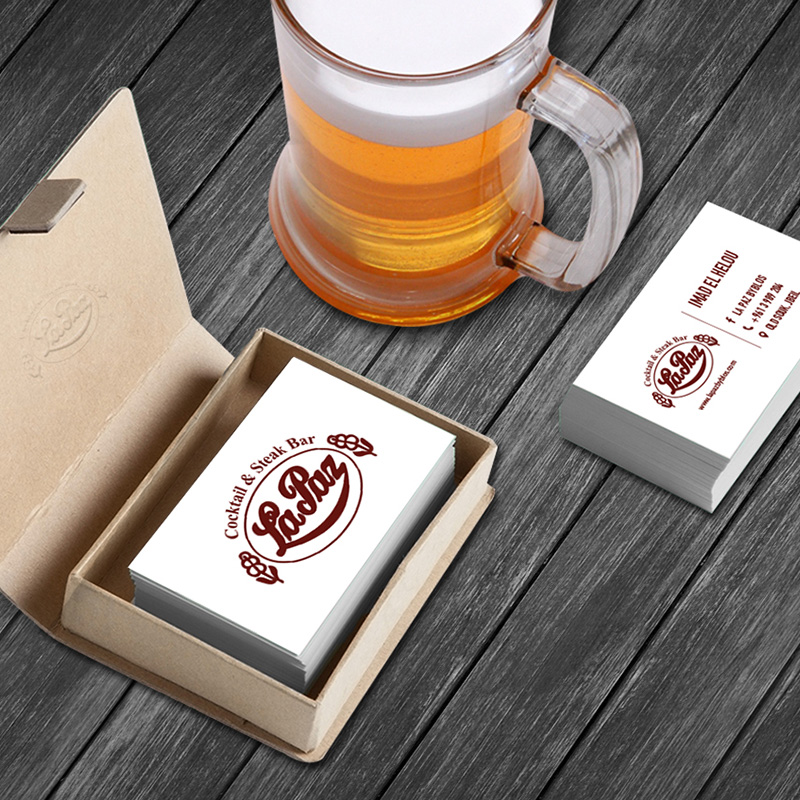 Lapaz business card with logo next to beer glass