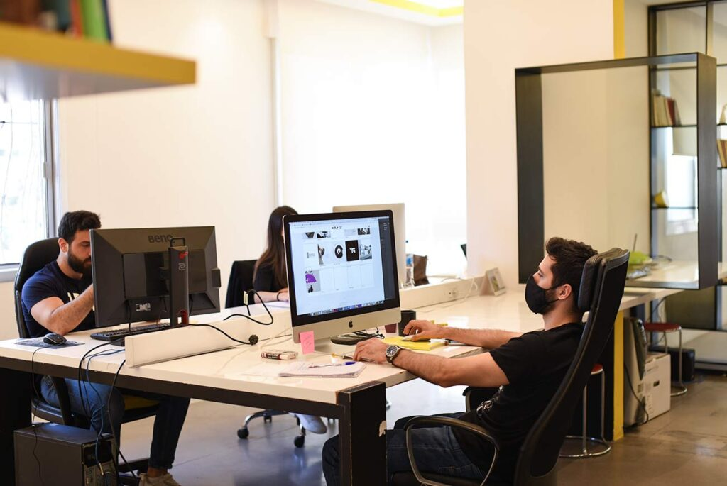 Notaclinic employees working on new projects at the Beirut office